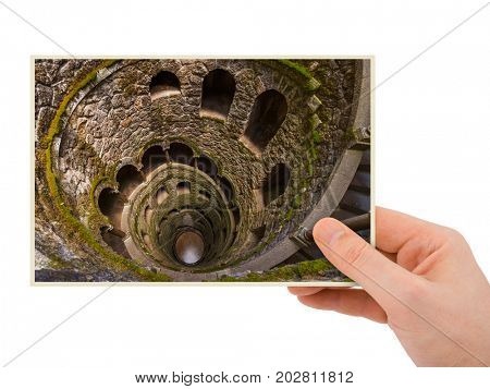 Hand and Initiation Well in Castle Quinta da Regaleira - Sintra Portugal (my photo) isolated on white background