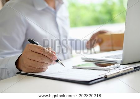 Teenager owner work at home for online shopping checking order product with office equipment