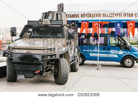 Istanbul, July 15, 2017: A military machine and a police car in the Buykeshehir district of Istanbul. Strengthening of security measures during the high tourist season. Protection of the population from crime.