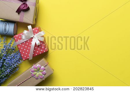 Gift box and gift shopping on yellow background view from above with copy space