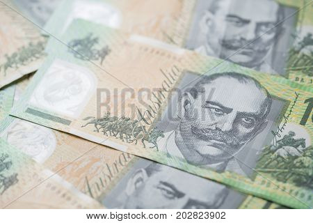 close up of Australian one hundred dollar bills finance currency and business concept
