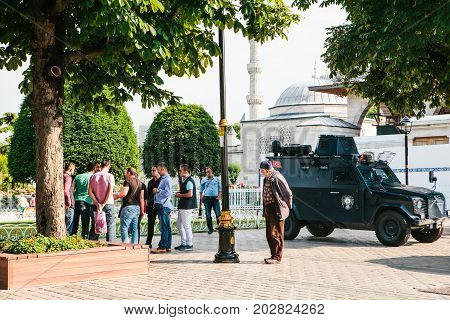 Istanbul, July 15, 2017: Military vehicle and police car in Sultanahmet Square in Istanbul. Conflict situation requires intervention of law enforcement officials. Protection of the population against crime.