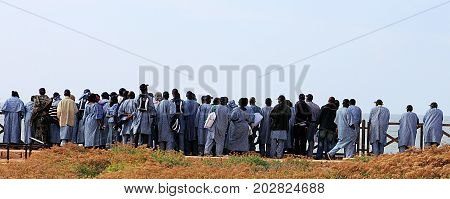 African tourists looking at the sea in Caesarea, Israel