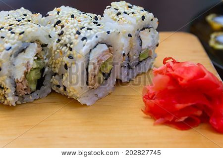 Salmon Maki Sushi - Roll with Salmon , Cucumber and Avocado inside.