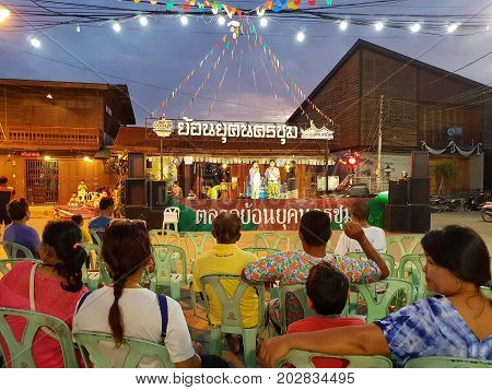 KAMPHAENG PHET THAILAND - MAY 6 : unidentified people watching show on stage in public area market on May 6 2017 in Kamphaeng Phet Thailand.