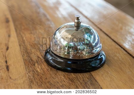 Restaurant service bell on the tableBusiness concept Serve today hotel kitchen or bar visit.