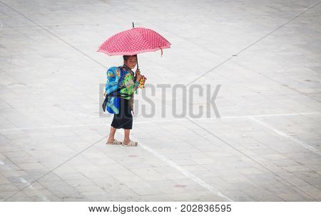 SA PA, VIETNAM - AUGUST 2017: Black hmog ethnic minority girl in Sa Pa town, the high mountains, Lao Cai province, Vietnam