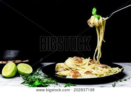 Spaghetti with shrimps and cream sauce  twirled on fork