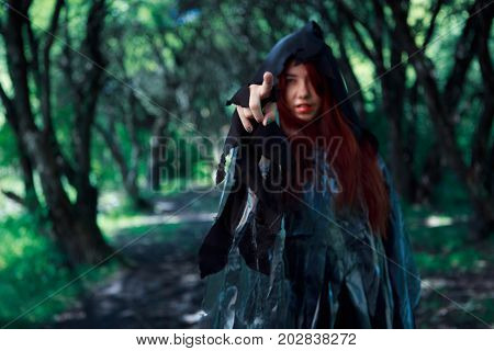 Picture of witch in cloak
