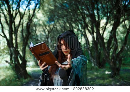 Witch reads book of spells