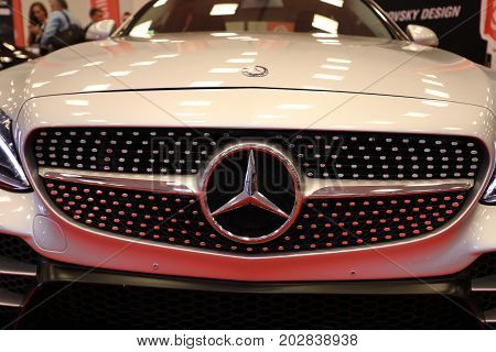 CRACOW POLAND - MAY 20 2017: Mercedes metallic logo closeup on Mercedes car displayed at MOTO SHOW in Cracow Poland. Exhibitors present most interesting aspects of the automotive industry