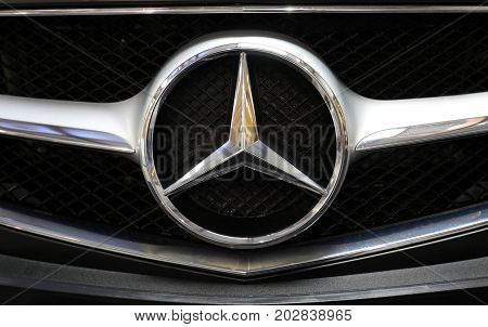 CRACOW POLAND - MAY 20 2017: Mercedes metallic logo closeup on Mercedes car displayed at 3rd edition of MOTO SHOW in Cracow Poland. Exhibitors present most interesting aspects of the automotive industry