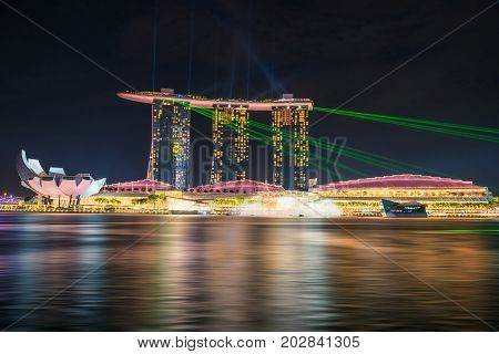 SINGAPORE - October 23 2016 : Night life of lights show at Marina Bay Sand. Singapore Marina Bay Cityscape.