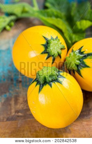 Round Yellow Courgette Or Zucchini, On Wooden Background, Close Up