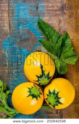 Round Yellow Courgette Or Zucchini, On Wooden Background, Copy Space