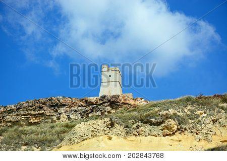 View of Ghajn Tuffieha watchtower which overlooks the coastline Golden Bay Malta Europe.