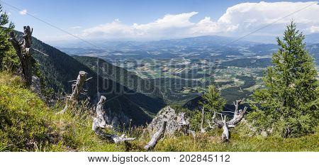 View from mountain Petzen to valley Drau in Carinthia in Austria