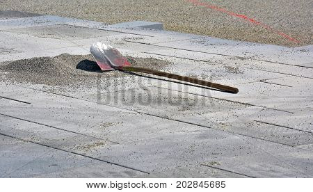 Shovel on the ground of a buidling site