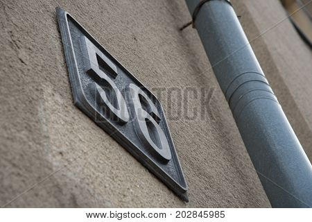 The number on the house is fifty-six and the pipe. Black letters are used as captcha