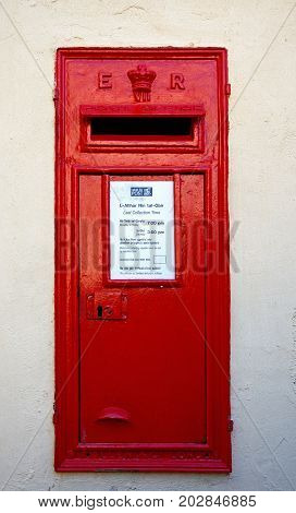 MDINA, MALTA - MARCH 29, 2017 - Traditional red British postbox in a wall Mdina Malta Europe, March 29, 2017.