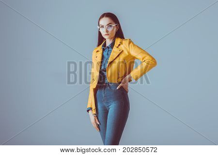 Stylish Woman In Leather Jacket And Eyeglasses