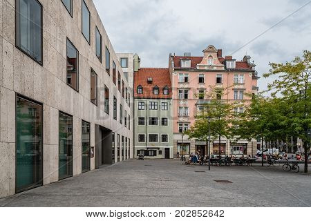 Munich, Germany - August 3, 2017: Scenic view of street in historical city centre of Munich a cloudy day of summer. Sankt-Jakobs-Platz a cloudy day of summer.
