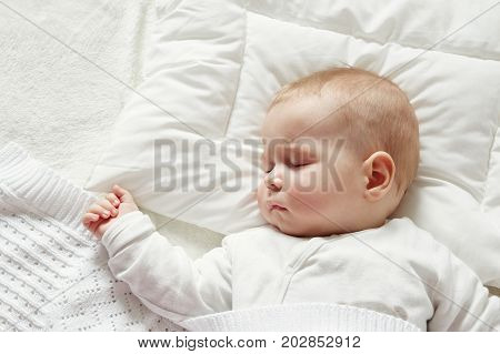 little boy sleeping on soft white blanket. 7 month old baby asleep poster