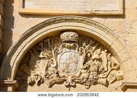 Coat of arms on the front of St Pauls Cathedral also known as Mdina Cathedral Mdina Malta Europe.