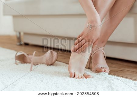 Woman Taking Shoes Off