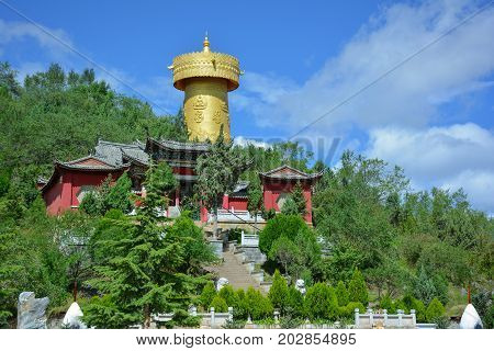 Buddhist monastery and the biggest prayer wheel in the world on the Shangri-La central square. Yunnan province China.