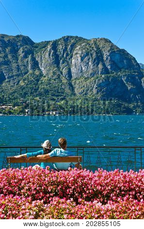 Bellagio Italy - August 31 2010: A young couple looking at the Como lake