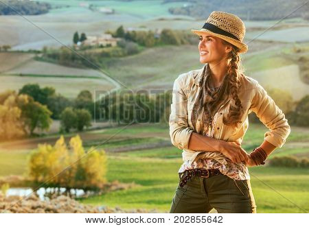 Woman Hiker Enjoying Evening In Tuscany & Looking Into Distance