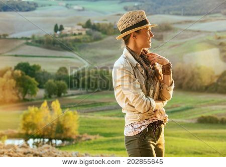 Woman Hiker In Tuscany Looking Into Distance
