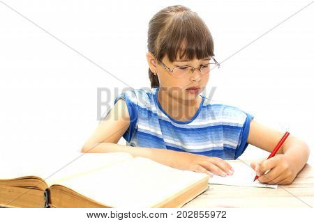 teenager with books on a white background, fatigue and sadness in his eyes.