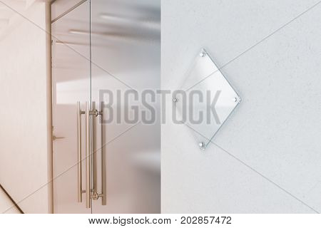 Blank rhombus transparent glass sign plate mock up 3d rendering. Nameplate mockup on the wall near office entrance interior. Signage panel store door template. Clear printing board for branding.