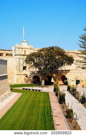 Footbridge leading to the Town Gate and city centre Mdina Malta Europe.