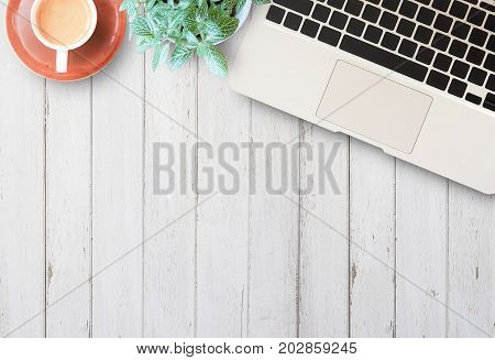 Flat lay home business desk with communication device. High angle view of office desk with copy space. Table with laptop and cup of coffee.Freelancer or student desk.Top view with copy space for use
