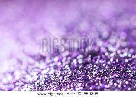 Purple Festive Christmas background. Abstract twinkled bright background with bokeh defocused lights
