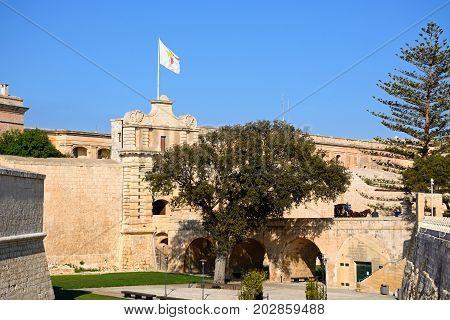 MDINA, MALTA - MARCH 29, 2017 - Footbridge leading to the Town Gate and city centre Mdina Malta Europe, March 29, 2017.