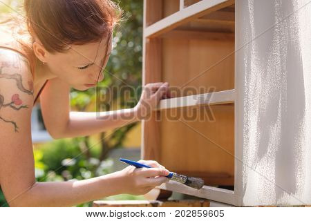 Woman Is Painting  Furniture