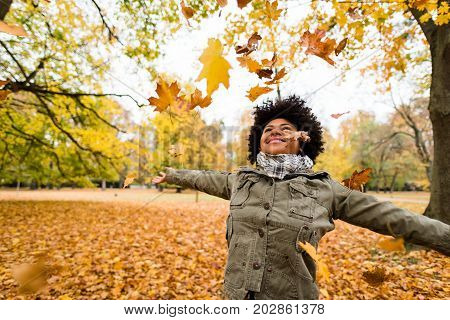Teen carefree girl enjoy the autumn, arms outstretched.