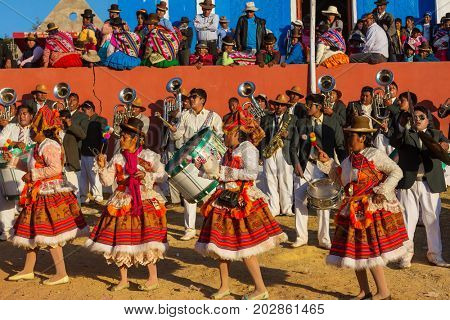 PUNO, PERU - AUGUST 07: Authentic Colorful Carnival on the streets of Puno, Peru near the high altutude Titicaca lake on August 7th, 2017