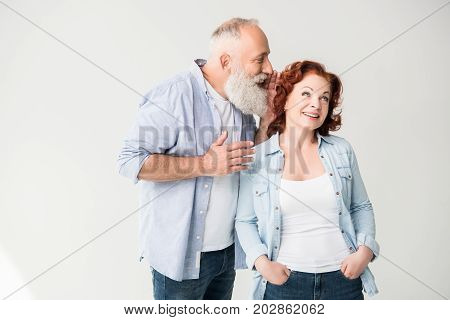 Man Whispering To His Wife