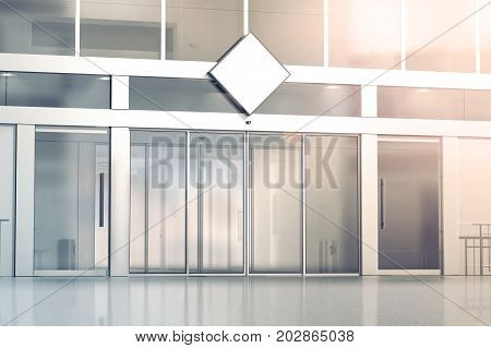 Blank white rhombus signage mockup on the store glass sliding doors entrance 3d rendering. Commercial building automatic entry banner mock up. Closed transparent business centre facade front view.