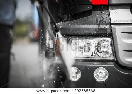 Manual Truck Washing Using High Pressured Hot Water with Detergents. Closeup Photo.