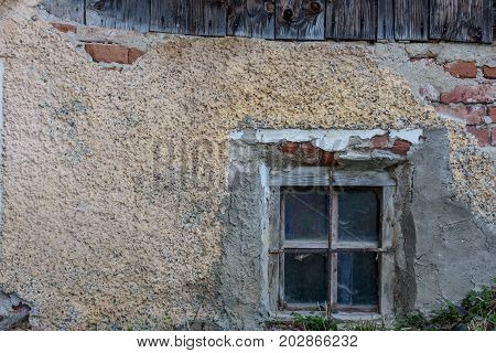 an old rotten window in an old abandoned house