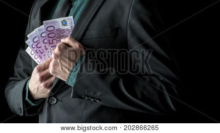 Businessman In Business Suit Holding 500 Euro Bills Near Inside Pocket Of His Jacket