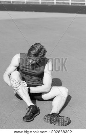 Injured Runner On Running Track Feeling Pain Of Broken Leg
