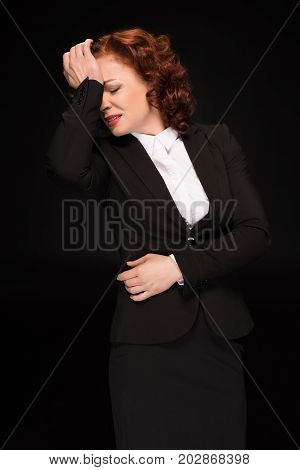 Businesswoman Touching Forehead