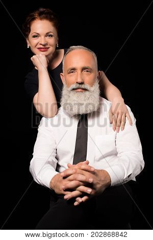 Man Sitting With Wife Standing Behind